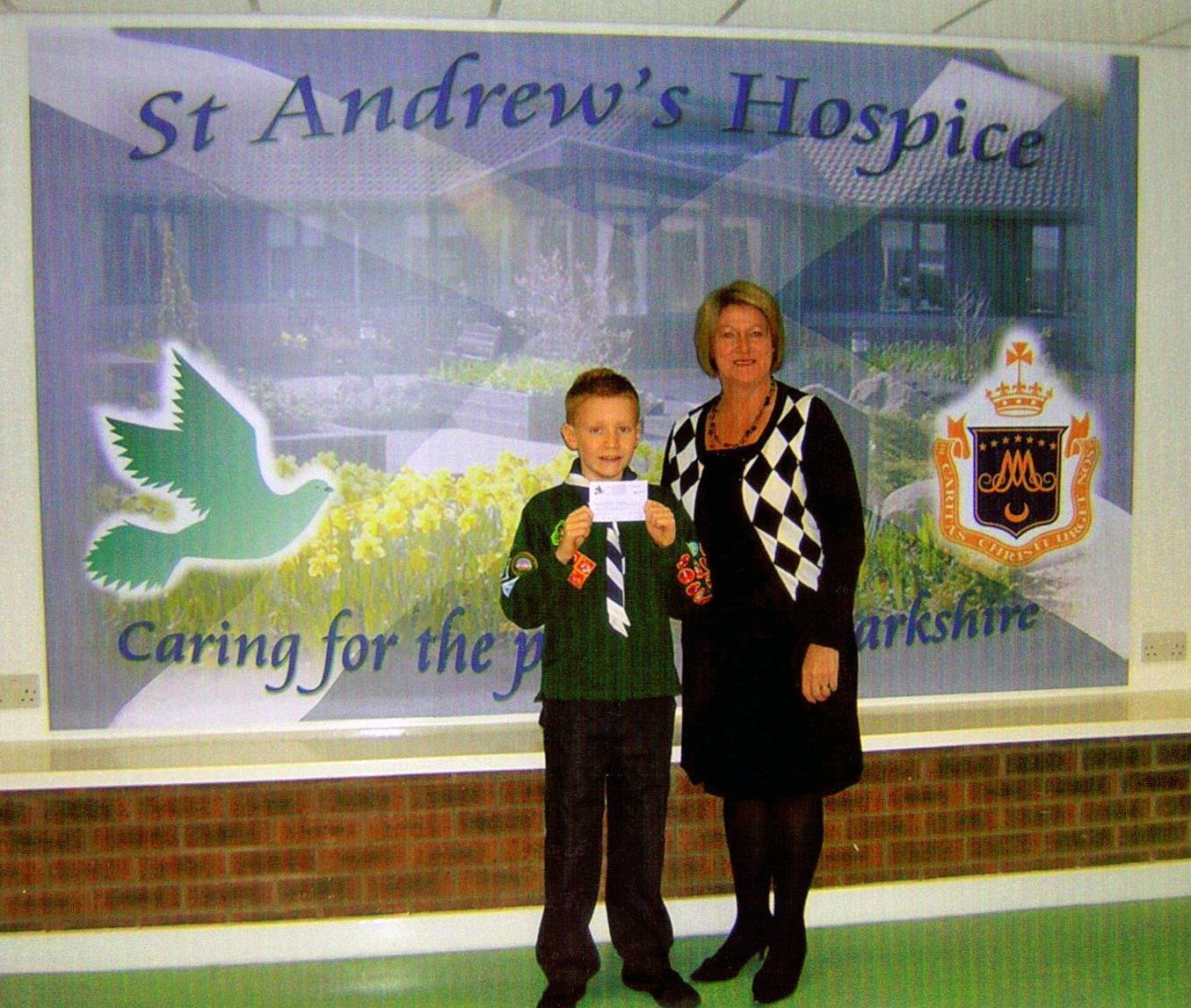 Scott presents the money to the Hospice